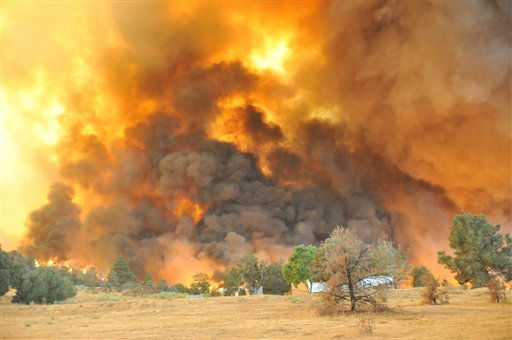 "<div class=""meta ""><span class=""caption-text "">A large wildfire to the southwest of Tehachapi, Calif. burns on Sunday, Sept. 4, 2011. A single-engine Cessna 210 went down in Blackburn Canyon near the small community of Tehachapi, sparking a raging brush fire that sent up a huge plume of smoke visible for miles around, according to Kern County fire department spokesman Cary Wright. (AP Photo/Dave Mills) (AP Photo/ Dave Mills)</span></div>"