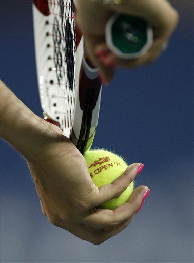 "<div class=""meta ""><span class=""caption-text "">Caroline Wozniacki, of Denmark, grips the tennis ball as she prepares to serve against Svetlana Kuznetsova, of Russia, during the U.S. Open tennis tournament in New York, Monday, Sept. 5, 2011. (AP Photo/Charles Krupa) (AP Photo/ Charles Krupa)</span></div>"