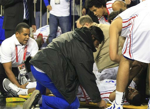 "<div class=""meta ""><span class=""caption-text "">Dominican Republic's Edgar Sosa, on the floor, is helped after breaking his right leg during a FIBA Americas Championship basketball game against Panama in Mar del Plata, Argentina, Monday, Sept. 5, 2011. The top two finishers of the tournament get an automatic berth in the 2012 London Olympics and the next three advance to the last-chance Olympic qualifier to be held in July 2012.(AP Photo/Martin Mejia) (AP Photo/ Martin Mejia)</span></div>"