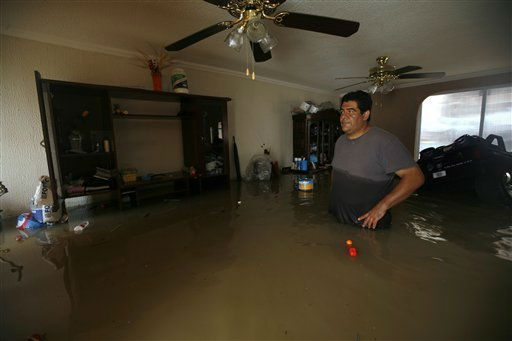 A man looks on inside his flooded house after heavy rains in Cuautitlan, outskirts of Mexico City, Monday, Sept. 5, 2011. &#40;AP Photo&#47;Marco Ugarte&#41; <span class=meta>(AP Photo&#47; Marco Ugarte)</span>