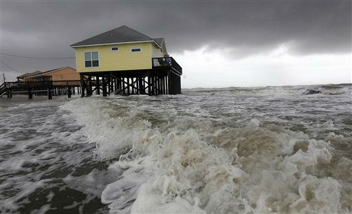 Squalls and heavy surf pounds homes along the beach in Dauphin Island, Ala., Monday, Sept.  5, 2011. The heavy waves were breaking under homes, damaging underpinnings and ripping porches and steps from the structures. Tropical Storm Lee is moving inland along the Gulf Coast bringing torrential rains and flooding. &#40;AP Photo&#47;Dave Martin&#41; <span class=meta>(AP Photo&#47; Dave Martin)</span>
