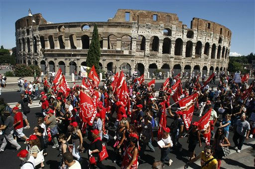 Demonstrators march past the Colosseum during a general strike in Rome, Tuesday, Sept. 6, 2011. With Silvio Berlusconi&#39;s government under increasing pressure to produce credible measures to balance the budget, a strike by Italy&#39;s largest labor union against an austerity package shut down air, land and sea transport, stalled manufacturing and curtailed government services throughout the country on Tuesday. Susanna Camusso, head of the left-leaning CGIL, said the euro 45.5 billion &#40;&#36;68 billion&#41; austerity package needs to be thrown out and substituted with fairer measures. &#40;AP Photo&#47;Pier Paolo Cito&#41; <span class=meta>(AP Photo&#47; Pier Paolo Cito)</span>