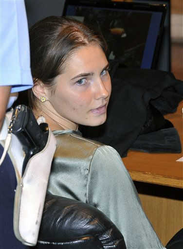 Amanda Knox attends an hearing of her appeals case at the Perugia court, Italy, Tuesday, Sept. 6, 2011. The police official who conducted the original investigation in the Amanda Knox case defended her standards Monday, after an independent review harshly criticized the evidence used to convict the American student of murdering her British roommate. Knox and her co-defendant and one-time boyfriend, Raffaele Sollecito, were convicted of sexually assaulting and killing Meredith Kercher in the apartment that Knox and the 21-year-old Briton shared while studying in Perugia. Knox was sentenced to 26 years in prison; Sollecito to 25. Both deny wrongdoing and have appealed the December 2009 verdict. &#40;AP Photo&#47;Stefano Medici&#41; <span class=meta>(AP Photo&#47; Stefano Medici)</span>