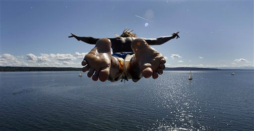 A young boy jumps from a tower into the Ammersee lake in Utting, southern Germany, on Tuesday, Sept. 6, 2011. Weather forecasters predict warm and sunny weather in southern Germany for the upcoming days.  &#40;AP Photo&#47;Matthias Schrader&#41; <span class=meta>(AP Photo&#47; Matthias Schrader)</span>