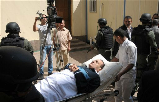 "<div class=""meta ""><span class=""caption-text "">Former Egyptian president Hosni Mubarak  lies on his bed while being taken to the courtroom for another session of his trial in Cairo, Egypt, on Wednesday Sept. 7, 2011. The 83-year-old ousted President returned to court for a fourth hearing in his trial on charges of corruption and complicity in the killing of protesters during the 18-day-uprising that toppled him.(AP Photo) (AP Photo/ Anonymous)</span></div>"