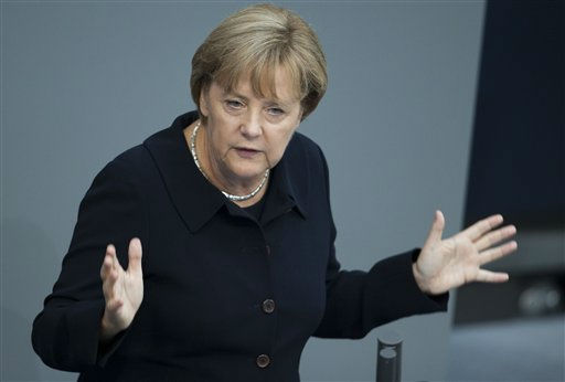 German Chancellor Angela Merkel delivers a speech during a general debate about her policy as part of the budget 2012 debate in Berlin, Wednesday, Sept. 7, 2011.  Merkel says the high court&#39;s decision to uphold the country&#39;s participation in eurozone bailout funds &#34;absolutely confirms&#34; her government&#39;s actions.  Merkel told parliament Wednesday after the decision that the euro meant more to Europe than just a common monetary zone, noting that no countries with a shared currency had ever gone to war with one another. &#40;Photo&#47;Markus Schreiber&#41; <span class=meta>(AP Photo&#47; Markus Schreiber)</span>