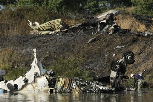 Wreckage of Russian Yak-42 jet, carrying a top ice hockey team, seen near the city of Yaroslavl, on the Volga River about 150 miles &#40;240 kilometers&#41; northeast of Moscow,  Russia, Wednesday, Sept. 7, 2011. A Russian jet carrying a top ice hockey team crashed while taking off Wednesday in western Russia, killing at least 36 people and leaving one critically injured, officials said.The Russian Emergency Situations Ministry said the Yak-42 plane crashed immediately after leaving an airport near the city of Yaroslavl, on the Volga River about 150 miles &#40;240 kilometers&#41; northeast of Moscow. It said one person survived the crash with grave injuries.&#40;AP Photo&#47;Misha Japaridze&#41; <span class=meta>(AP Photo&#47; Misha Japaridze)</span>
