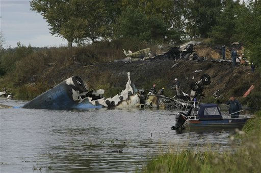 Rescuers work at the crash site of Russian Yak-42 jet near the city of Yaroslavl, on the Volga River about 150 miles &#40;240 kilometers&#41; northeast of Moscow,  Russia, Wednesday, Sept. 7, 2011. The Yak-42 jet carrying a top ice hockey team crashed while taking off Wednesday in western Russia. The Russian Emergency Situations Ministry said the plane was carrying the Lokomotiv ice hockey team from Yaroslavl.&#40;AP Photo&#47;Misha Japaridze&#41; <span class=meta>(AP Photo&#47; Misha Japaridze)</span>