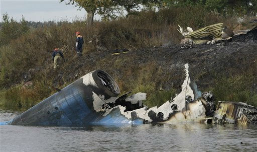 Rescuers seen at the crash site of Russian Yak-42 jet near the city of Yaroslavl, on the Volga River about 150 miles &#40;240 kilometers&#41; northeast of Moscow,  Russia, Wednesday, Sept. 7, 2011. The Yak-42 jet carrying a top ice hockey team crashed while taking off Wednesday in western Russia. The Russian Emergency Situations Ministry said the plane was carrying the Lokomotiv ice hockey team from Yaroslavl. &#40;AP Photo&#47;Misha Japaridze&#41; <span class=meta>(AP Photo&#47; Misha Japaridze)</span>