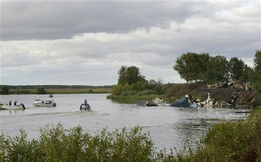 "<div class=""meta ""><span class=""caption-text "">Rescuers work at the crash site of Russian Yak-42 jet near the city of Yaroslavl, on the Volga River about 150 miles (240 kilometers) northeast of Moscow,  Russia, Wednesday, Sept. 7, 2011. The Yak-42 jet carrying a top ice hockey team crashed while taking off Wednesday in western Russia. The Russian Emergency Situations Ministry said the plane was carrying the Lokomotiv ice hockey team from Yaroslavl.(AP Photo/Misha Japaridze) (AP Photo/ Misha Japaridze)</span></div>"