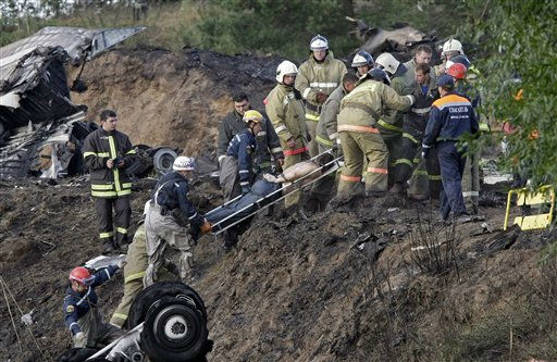 Rescuers lift a stretcher with the body of a victim out of the river, at the crash site of Russian Yak-42 jet near the city of Yaroslavl, on the Volga River about 150 miles &#40;240 kilometers&#41; northeast of Moscow,  Russia, Wednesday, Sept. 7, 2011. The Yak-42 jet carrying a top ice hockey team crashed while taking off Wednesday in western Russia. The Russian Emergency Situations Ministry said the plane was carrying the Lokomotiv ice hockey team from Yaroslavl.&#40;AP Photo&#47;Misha Japaridze&#41; <span class=meta>(AP Photo&#47; Misha Japaridze)</span>