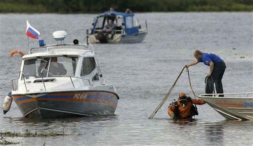 Rescuers work on the river at the crash site of Russian Yak-42 jet near the city of Yaroslavl, on the Volga River about 150 miles &#40;240 kilometers&#41; northeast of Moscow,  Russia, Wednesday, Sept. 7, 2011. The Yak-42 jet carrying a top ice hockey team crashed while taking off Wednesday in western Russia. The Russian Emergency Situations Ministry said the plane was carrying the Lokomotiv ice hockey team from Yaroslavl.&#40;AP Photo&#47;Misha Japaridze&#41; <span class=meta>(AP Photo&#47; Misha Japaridze)</span>