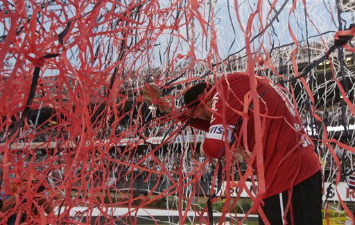 Sao Paulo FC&#39; s goalkeeper Rogerio Ceni is covered by confetti at the end of a Brazilian soccer league game against Atletico Mineiro in Sao Paulo, Brazil, Wednesday, Sept. 7, 2011. Ceni played the 1000th game for his team, Sao Paulo, that won 2-1. &#40;AP Photo&#47;Andre Penner&#41; <span class=meta>(AP Photo&#47; Andre Penner)</span>