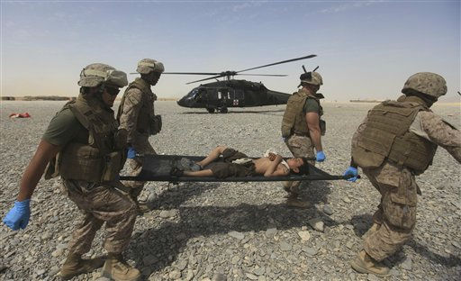 Medical nurses of U.S Marines carry the injuried Afghan boy to hospital after he fell from a wall at Forward Operating Base Edi in the Helmand Province of southern Afghanistan, Wednesday, Sept. 7, 2011.&#40;AP Photo&#47;Rafiq Maqbool&#41; <span class=meta>(AP Photo&#47; Rafiq Maqbool)</span>