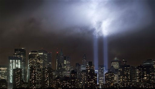 "<div class=""meta ""><span class=""caption-text "">A test of the Tribute in Light rises above lower Manhattan, Tuesday, Sept. 6, 2011, in New York. Four World Trade Center, second from left, is under construction. The memorial, sponsored by the Municipal Art Society, will light the sky on the evening of Sept. 11, 2011, in honor of those who died ten years ago in the terror attacks on the United States. (AP Photo/Mark Lennihan) (AP Photo/ Mark Lennihan)</span></div>"