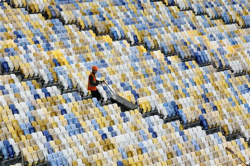 A worker pushes a wheelbarrow past rows of seats as construction continues at the Olympiyskiy national stadium, which will host the final soccer match of Euro 2012 in Kiev, Ukraine, Thursday, Sept. 8, 2011. The Olympiyskiy stadium will open on October 8, 2011. &#40;AP Photo&#47;Efrem Lukatsky&#41; <span class=meta>(AP Photo&#47; Efrem Lukatsky)</span>