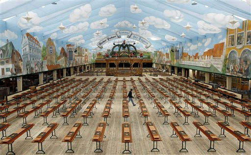 A worker walks through the Hacker Pschorr beer tent during preparations for the 178th Oktoberfest beer festival in Munich, southern Germany, Thursday, Sept. 8, 2011. The world&#39;s largest beer festival, to be held from Sept. 17 to Oct. 3, 2011 is expected to draw several millions visitors. &#40;AP Photo&#47;Matthias Schrader&#41; <span class=meta>(AP Photo&#47; Matthias Schrader)</span>