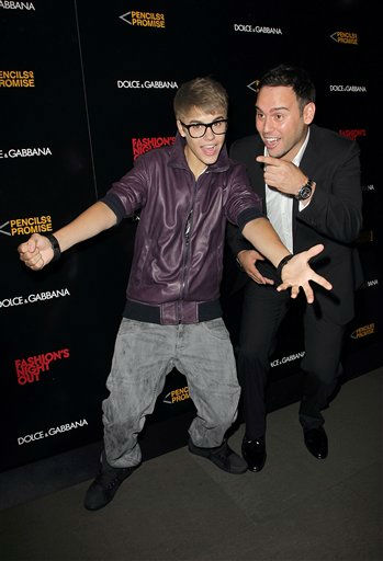Singer Justin Bieber, left, and and Scooter Braun attend the Fashion Night Out Dolce &amp; Gabbana at the Dolce &amp; Gabbana store on Madison &amp; 69th street on Thursday, Sept. 8, 2011. &#40;AP Photo&#47;Donald Traill&#41; <span class=meta>(AP Photo&#47; Donald Traill)</span>