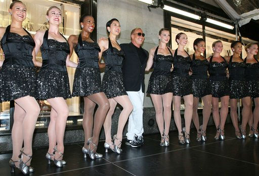 Designer Michael Kors, center, stands with The Rockettes after their performance outside the new Michael Kors Rockefeller Center Lifestyle flagship store as they celebrate Fashion&#39;s Night Out Thursday Sept. 8, 2011 in New York.   &#40;AP Photo&#47;Tina Fineberg&#41; <span class=meta>(AP Photo&#47; Tina Fineberg)</span>