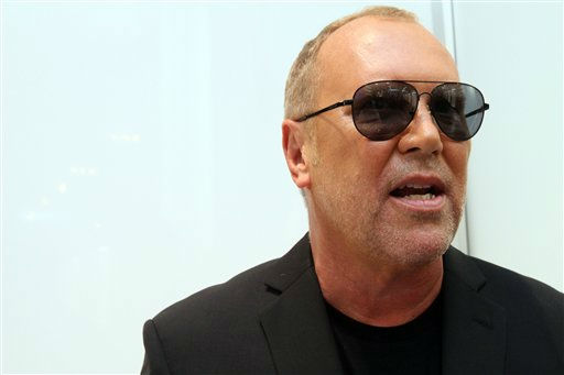 Michael Kors responds as he is interviewed at the new Michael Kors Rockefeller Center Lifestyle flagship store during  Fashion&#39;s Night Out, Thursday, Sept. 8, 2011, in New York.   &#40;AP Photo&#47;Tina Fineberg&#41; <span class=meta>(AP Photo&#47; Tina Fineberg)</span>