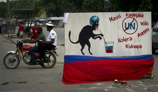 A free-standing mural depicting a U.N. peacekeeper as an animal is displayed in the median of a downtown street of Port-au-Prince, Haiti, Thursday Sept. 8, 2011. The words in Creole read, from left, clockwise: Homosexual, rapists, robber, killer, kidnappers and cholera. The mural appeared in recent days in response to allegations that Uruguayan peacekeepers sexually abused a young Haitian man inside their U.N. base. Demonstrators in Haiti this week have stoked anger over the scandal and called for an immediate pullout of the U.N. force. &#40;AP Photo&#47;Ramon Espinosa&#41; <span class=meta>(AP Photo&#47; Ramon Espinosa)</span>