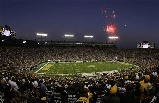 "<div class=""meta ""><span class=""caption-text "">Fans watch fireworks over Lambeau Field before the season-opening NFL football game between the Green Bay Packers and the New Orleans Saints Thursday, Sept. 8, 2011, in Green Bay, Wis. (AP Photo/Morry Gash) (AP Photo/ Morry Gash)</span></div>"