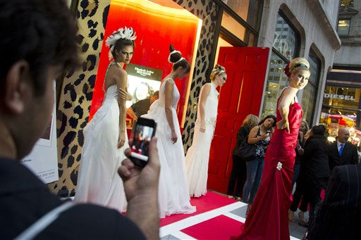 Models pose outside the Elizabeth Arden store on Fifth Avenue during Fashion?s Night Out in New York, Thursday, Sept. 8, 2011. &#40;AP Photo&#47;Charles Sykes&#41; <span class=meta>(AP Photo&#47; Charles Sykes)</span>