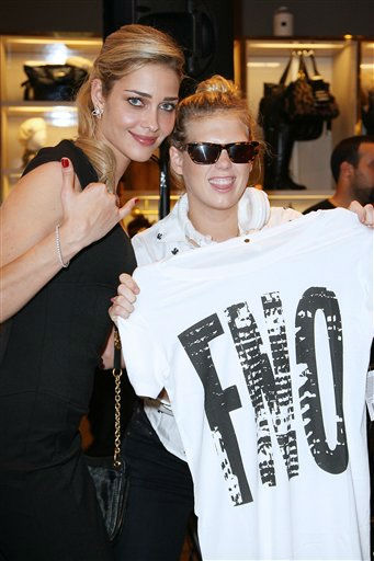 Brazilian model Ana Beatriz Barros, left, poses with Alexandra Richards, daughter of Rolling Stones guitarist Keith Richards, at Juicy Couture&#39;s Fashion&#39;s Night Out event on Thursday, Sept. 8, 2011 in New York. &#40;AP Photo&#47;Starpix, Kristina Bumphrey&#41; <span class=meta>(AP Photo&#47; Kristina Bumphrey)</span>