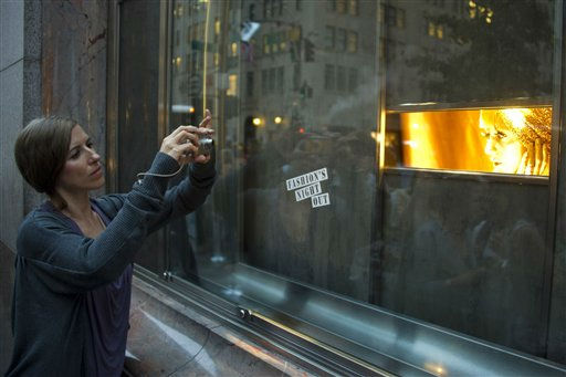 "<div class=""meta ""><span class=""caption-text "">A model poses in the window of Tiffany & Co. on Fifth Avenue during Fashion?s Night Out in New York, Thursday, Sept. 8, 2011. (AP Photo/Charles Sykes) (AP Photo/ Charles Sykes)</span></div>"