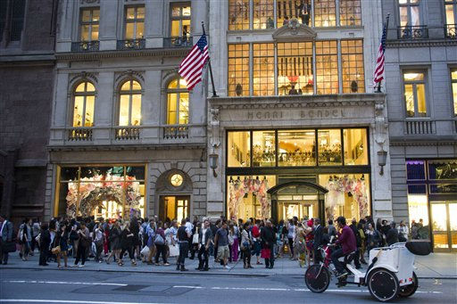 Shoppers gather outside the Henri Bendel store on Fifth Avenue during Fashion?s Night Out in New York, Thursday, Sept. 8, 2011. &#40;AP Photo&#47;Charles Sykes&#41; <span class=meta>(AP Photo&#47; Charles Sykes)</span>