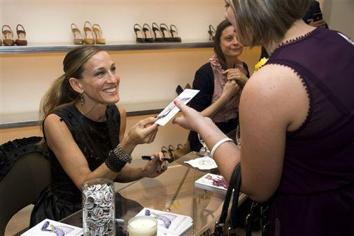 "<div class=""meta ""><span class=""caption-text "">Sarah Jessica Parker signs autographs at the Manolo Blahnik store as part of Fashion?s Night Out in New York, Thursday, Sept. 8, 2011. (AP Photo/Charles Sykes) (AP Photo/ Charles Sykes)</span></div>"