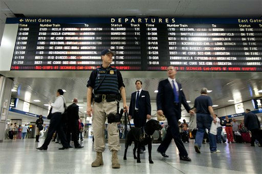 An Amtrack K-9 division police officer stands guard at Pennsylvania Station on Friday, Sept. 9, 2011 in New York. The city is deploying additional resources and taking other security steps in response to a potential terror threat before the 10th anniversary of the Sept. 11 attacks. U.S. counterterrorism officials are chasing a credible but unconfirmed al-Qaida threat to use a car bomb on bridges or tunnels in New York or Washington. &#40;AP Photo&#47;Jin Lee&#41; <span class=meta>(AP Photo&#47; Jin Lee)</span>