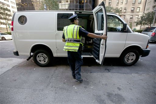 A New York City police officer examines a commercial vehicle at a checkpoint on 59th St. and Park Ave. on Friday, Sept. 9, 2011 in New York. The city is deploying additional resources and taking other security steps in response to a potential terror threat before the 10th anniversary of the Sept. 11 attacks. U.S. counterterrorism officials are chasing a credible but unconfirmed al-Qaida threat to use a car bomb on bridges or tunnels in New York or Washington. &#40;AP Photo&#47;Jin Lee&#41; <span class=meta>(AP Photo&#47; Jin Lee)</span>