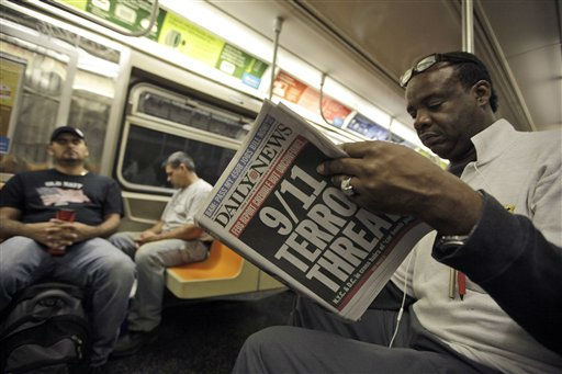 An early morning subway commuter reads a newspaper with a front page announcing news of an al-Qaida terror threat, Friday, Sept. 9, 2011 in New York. Just days before the 10th anniversary of the Sept. 11 attacks, U.S. counterterrorism officials are chasing a credible but unconfirmed al-Qaida threat to use a car bomb on bridges or tunnels in New York City or Washington. It is the first &#34;active plot&#34; timed to coincide with the somber commemoration of the terror group&#39;s 9&#47;11 attacks a decade ago that killed nearly 3,000 people.  &#40;AP Photo&#47;Mary Altaffer&#41; <span class=meta>(Photo&#47;Mary Altaffer)</span>