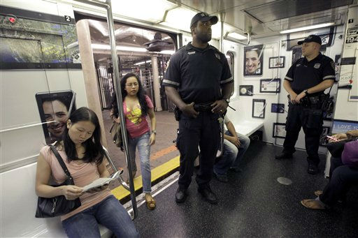 "<div class=""meta ""><span class=""caption-text "">A couple of police officers ride the shuttle between New York's Times Square and Grand Central Station, Friday, Sept. 9, 2011. Just days before the 10th anniversary of the Sept. 11 attacks, U.S. counterterrorism officials are chasing a credible but unconfirmed al-Qaida threat to use a car bomb on bridges or tunnels in New York City or Washington. (AP Photo/Mary Altaffer) (Photo/Mary Altaffer)</span></div>"