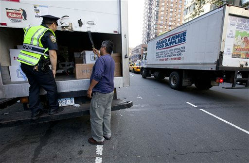 A New York City police officer examines a delivery truck at a vehicle check point on Friday, Sept. 9, 2011 in New York. The city is deploying additional resources and taking other security steps in response to a potential terror threat before the 10th anniversary of the Sept. 11 attacks. U.S. counterterrorism officials are chasing a credible but unconfirmed al-Qaida threat to use a car bomb on bridges or tunnels in New York or Washington. &#40;AP Photo&#47;Jin Lee&#41; <span class=meta>(AP Photo&#47; Jin Lee)</span>