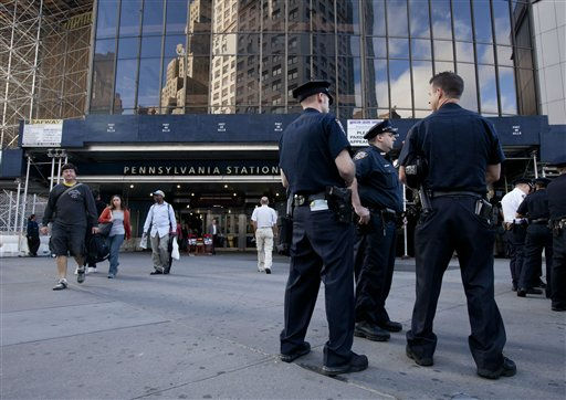 New York City police officers stand guard outside New York Pennsylvania Station on Friday, Sept. 9, 2011 in New York. The city is deploying additional resources and taking other security steps in response to a potential terror threat before the 10th anniversary of the Sept. 11 attacks. U.S. counterterrorism officials are chasing a credible but unconfirmed al-Qaida threat to use a car bomb on bridges or tunnels in New York or Washington. &#40;AP Photo&#47;Jin Lee&#41; <span class=meta>(AP Photo&#47; Jin Lee)</span>
