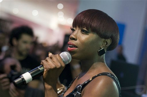 Estelle sings during a party at the Diane Von Furstenberg shop during Fashion&#39;s Night Out in New York, Thursday, Sept. 8, 2011. &#40;AP Photo&#47;Dan Balilty&#41; <span class=meta>(AP Photo&#47; Dan Balilty)</span>
