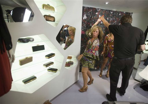 People dance during the Diane Von Furstenberg party for Fashion&#39;s Night Out at her shop in New York, Thursday, Sept. 8, 2011. &#40;AP Photo&#47;Dan Balilty&#41; <span class=meta>(AP Photo&#47; Dan Balilty)</span>