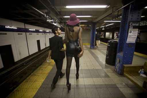 A couple walks through the Canal St. subway station during Fashion&#39;s Night Out in New York, Thursday, Sept. 8, 2011. &#40;AP Photo&#47;Dan Balilty&#41; <span class=meta>(AP Photo&#47; Dan Balilty)</span>