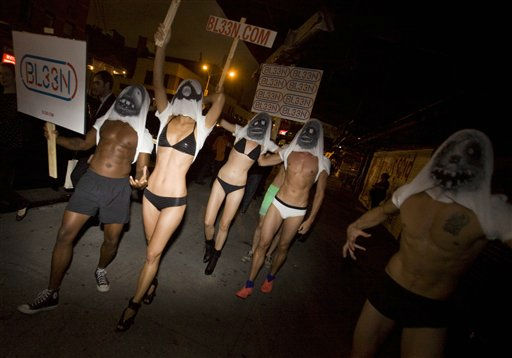 Men and women parade down the street while promoting monster T-shirts by Bl33n during Fashion&#39;s Night Out in New York, Thursday, Sept. 8, 2011. &#40;AP Photo&#47;Dan Balilty&#41; <span class=meta>(AP Photo&#47; Dan Balilty)</span>