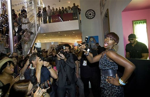 Singer Estelle sings during a party at the Diane Von Furstenberg shop during Fashion&#39;s Night Out in New York, Thursday, Sept. 8, 2011. &#40;AP Photo&#47;Dan Balilty&#41; <span class=meta>(AP Photo&#47; Dan Balilty)</span>