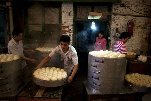 "<div class=""meta ""><span class=""caption-text "">Vendors prepare steamed buns for sale at a food market in Beijing, China, Friday, Sept. 9, 2011. China's inflation rate retreated from a three-year high in August as food price increases moderated, suggesting Beijing may be able to hold off on further monetary tightening as it copes with a slowing global economy. (AP Photo/Alexander F. Yuan) (AP Photo/ Alexander F. Yuan)</span></div>"