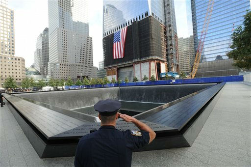Danny Shea, a New York City Police Officer and military veteran, salutes at the north pool of the Sept 11. Memorial, during 10th anniversary ceremonies at the World Trade Center site, Sunday, Sept.11, 2011, in New York. &#40;AP Photo&#47;David Handschuh, Pool&#41; <span class=meta>(AP Photo&#47; David,Handschuh,NY Daily News)</span>