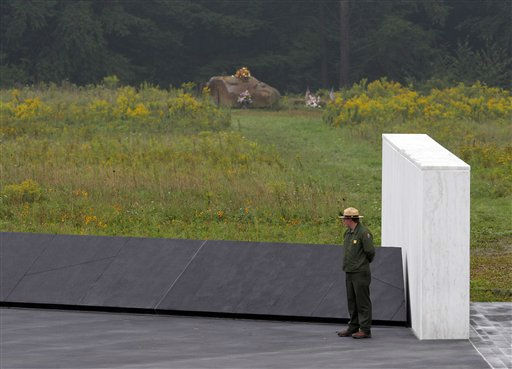 A National Park ranger stands near a section of phase I of the permanent Flight 93 National Memorial near the crash site of United Flight 93 in Shanksville, Pa. Saturday Sept. 10, 2011. A 17-ton boulder marking the crash site is seen in background.   &#40;AP Photo&#47;Amy Sancetta&#41; <span class=meta>(AP Photo&#47; Amy Sancetta)</span>
