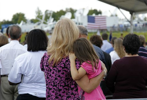 Visitors embrace as they attend the dedication of Phase 1 of the permanent Flight 93 National Memorial near the crash site of Flight 93 in Shanksville, Pa., Saturday, Sept. 10, 2011.  &#40;AP Photo&#47;Amy Sancetta&#41; <span class=meta>(AP Photo&#47; Amy Sancetta)</span>
