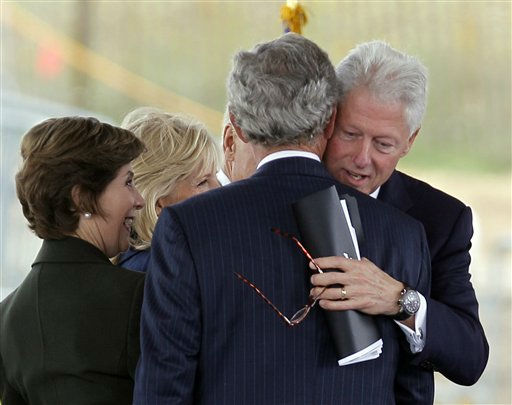 Former President Bill Clinton hugs former President George W. Bush after speaking  during the dedication of phase 1 of the permanent Flight 93 National Memorial near the crash site of Flight 93 in Shanksville, Pa., Saturday, Sept. 10, 2011.  &#40;AP Photo&#47;Amy Sancetta&#41; <span class=meta>(AP Photo&#47; Amy Sancetta)</span>