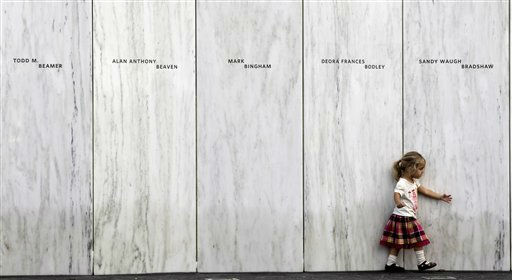 A family member of one of the victims of the crash of United Flight 93 walks along a section of Phase 1 of the permanent National Memorial following its dedication, near the crash site of Flight 93 in Shanksville, Pa., Saturday, Sept. 10, 2011.   The names of the 40 victims of the crash are inscribed on the marble panels. &#40;AP Photo&#47;Amy Sancetta&#41; <span class=meta>(AP Photo&#47; Amy Sancetta)</span>