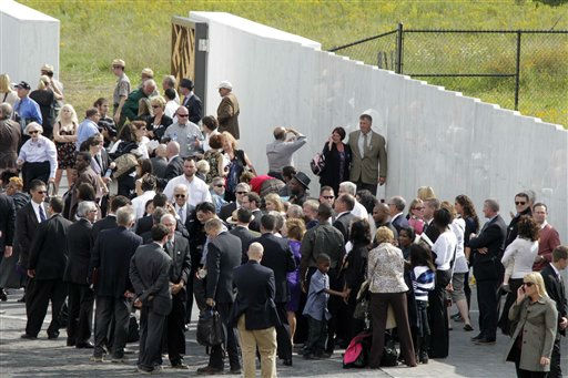 "<div class=""meta ""><span class=""caption-text "">Family and friends of the passengers and crew of Flight 93 gather at the Wall of Names after the dedication of the Flight 93 National Memorial  Sept. 10, 2011 in Shanksville, Pa.. (AP Photo/Gene J. Puskar) (AP Photo/ Gene J. Puskar)</span></div>"