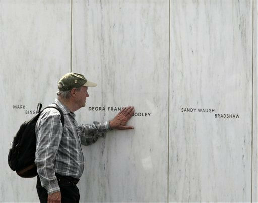 Family and friends of the passengers and crew of Flight 93 gather at the Wall of Names after the dedication of the Flight 93 National Memorial  Sept. 10, 2011 in Shanksville, Pa.. &#40;AP Photo&#47;Gene J. Puskar&#41; <span class=meta>(AP Photo&#47; Gene J. Puskar)</span>